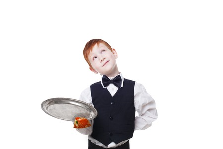 clumsy: Clumsy little waiter drops tray with small pizza piece while dreaming. Food falling down. Redhead child boy in suit shows inattentive waiter failure at white background