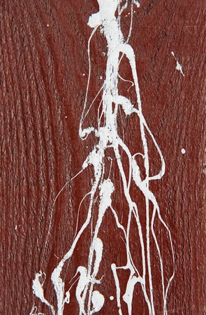 paint drips: Maroon, dark red wooden wall with white paint drips, drops and stains. Abstract background, rough grunge wood texture, old fence wall surface, vertical image