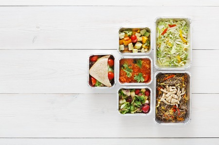 low carb diet: Healthy food delivery, daily ration. Take away of natural organic low carb diet. Fitness nutrition in foil boxes. Top view, flat lay with copy space at white wood