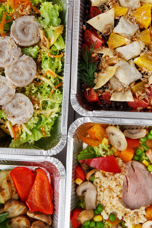 eat right: Healthy food background. Take away of natural organic food in foil boxes. Fitness nutrition, meat and vegetable salads. Top view, flat lay. Stock Photo