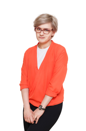 shy woman: Blond stylish shy woman in eyeglasses. Young fashionable businesswoman in casual clothes. Beautiful attractive female portrait isolated at white background. Stock Photo