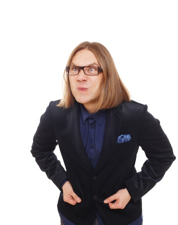 displeased businessman: Long haired angry man isolated at white. Portrait of stylish sly guy anxious grimaced and displeased of something. Trendy middle-aged person in glasses and blue suit.