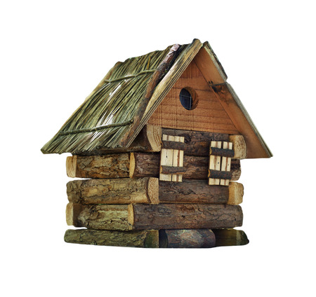 wooden toy: Model of simple village wooden log house isolated on white background. Toy decorative house made from rustic hardwood Stock Photo