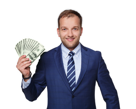 goodlooking: Portrait of a good-looking man showing a lot of dollars against white background