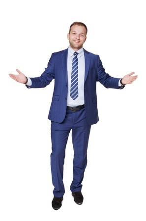 succesful: Young happy succesful businessman with open hands isolated on white. Portrait of a confident guy in trendy blue suit looking at camera and smiling