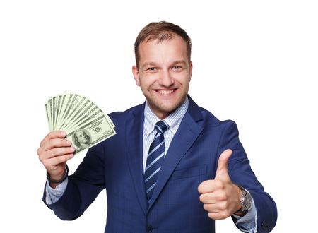 Porträt eines gut aussehenden Mann, der Geld zeigt Dollar Fan vor weißem Hintergrund. Geschäftsmann mit dem Pack von amerikanischen Währung zeigt Daumen nach oben. Finanzen und Business Erfolg, einfach Darlehen viel Geld. Lizenzfreie Bilder