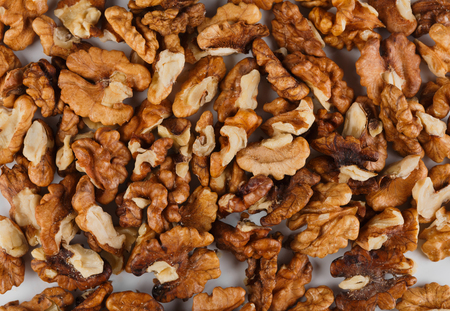 hazel nut: Pile of peeled skinless walnuts close-up as abstract food background. Lots of peeled brown hazel nut seeds, healthy vegan and vegetarian food, rich of energy low fat nutrition Stock Photo