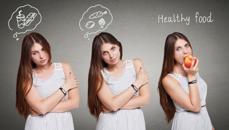 thinking cloud: Choose healthy food, eat right, diet concept. Beautiful long-haired young woman with thinking cloud about fast food and vegetables decides to eat red apple. Healthy lifestyle.