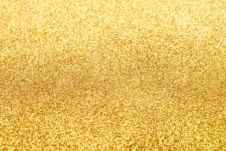 shimmer: Golden glitter texture abstract background. Yellow dusty shimmer decoration, shiny and sparkling. Holidays and glamour concept. Selective focus Stock Photo