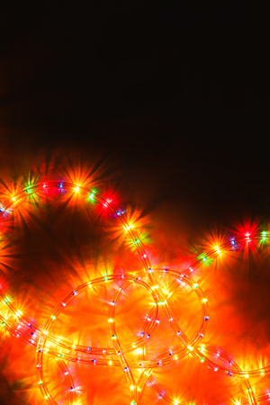 colored lighted christmas stars garland illumination christmas or other holiday decorations on black background with