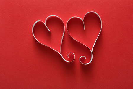 Valentine day background, handmade paper hearts on red Stock Photo