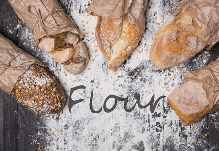 sorts: Bakery concept background. Bread sorts on flour