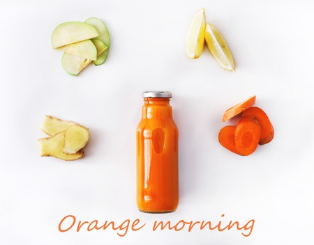 cleanse: Detox cleanse drink concept, vegetable orange smoothie ingredients. Natural, organic healthy juice in bottle for weight loss diet or fasting day. Carrot, apple, ginger and lemon mix isolated on white