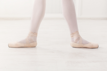 second floor: Ballerina legs second position in pointe, ballet dancer concept background