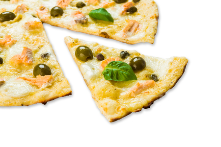 caper: Italian seafood pizza with shrimps, calamari rings, capers and olives - thin pastry crust isolated at white background, one piece cut off, closeup