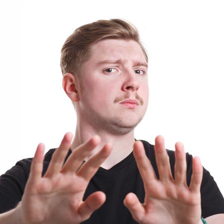 denying: No. Negative human emotion. Man expressing denying on white studio background, cutout