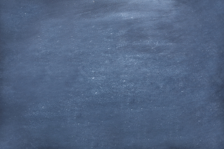 Dusty chalk textured abstract background. White powder splash covering black board surface, top view, copy space