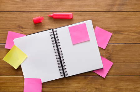 Dont forget things. Stationery supplies, top view flat lay shot of office wooden desk with open notepad, pen and many colorful blank memory stickers and memo notes, nobody, copy space, template Stock Photo