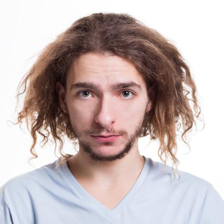 Feeling upset. Man with sad facial expression staring to camera on white isolated studio background, headshot Stock Photo