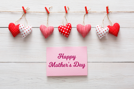 Happy mothers day background, greeting card and hearts on white wood. Love and family concept
