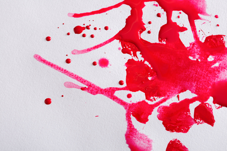 Abstract watercolor paint splash on paper texture background, red drops on white wall, top view, modern art