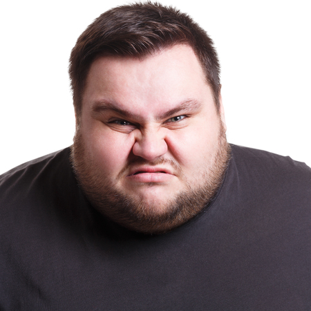 Angry fat man portrait, furious big guy expressing anger, white isolated studio background Stock Photo