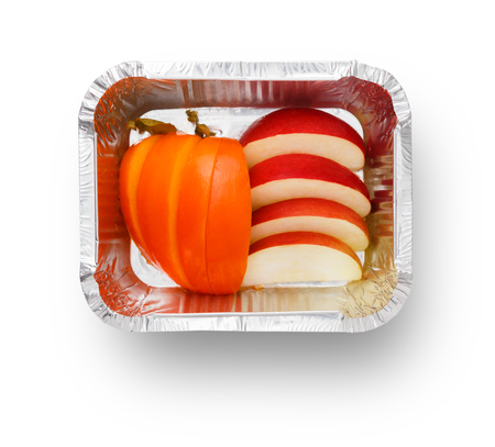 Healthy diet concept. Natural lunch, apples snack isolated. Take away organic food in foil container. Weight loss eating Stock Photo