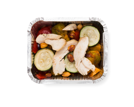 Healthy food restaurant delivery and diet concept. Take away meal in foil box. Steamed vegetables with chicken
