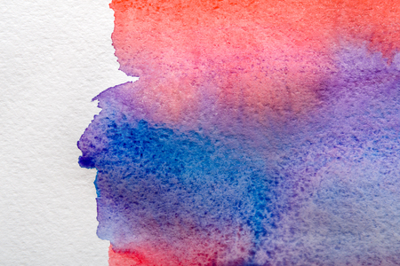 Abstract watercolor painted texture background. Red, violet and blue on white