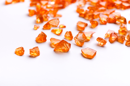 Orange Citrine gemstones on white background. Bright backdrop of natural jewels with free space for text, close up. Archivio Fotografico