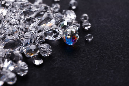 Beautiful diamonds on black background, free space. Pile of shiny crystals close-up. Jewelry, luxury, treasure concept Stock Photo