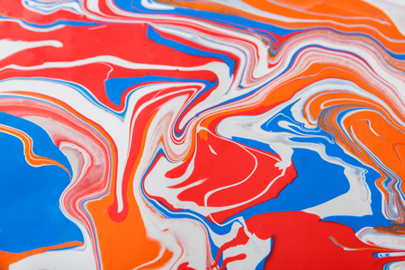 Liquid marbling paint background. Fluid painting abstract texture, blue and red. Intensive color mix