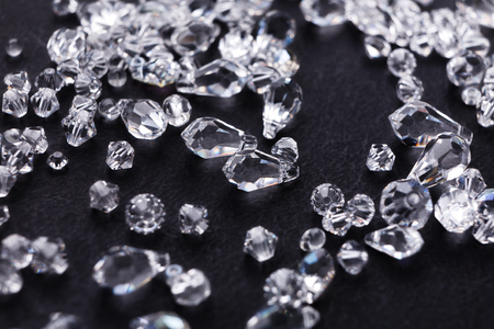 Beautiful diamonds on black background, close up. Pile of crystals close-up. Jewelry, luxury, treasure concept Stock Photo
