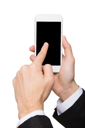 blank screen: Touch screen. Businessman hand point on mobile phone display, cutout. Man with modern smartphone, white isolated background, copy space Stock Photo