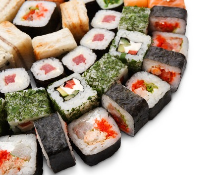Sushi platter closeup isolated on white background. Japanese food restaurant delivery - maki, cheese and california rolls set placed in circle Stock Photo