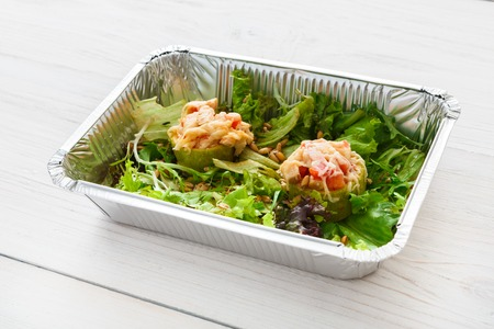 Healthy food delivery in foil closeup. Restaurant dishes, lunch for diet