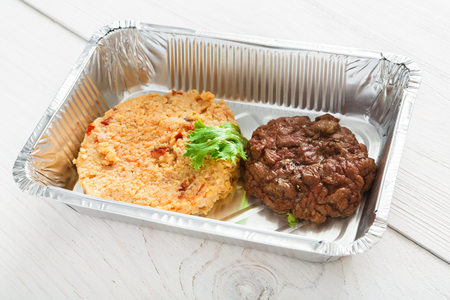 Healthy eating concept. Lunch foil box with meat and cereal
