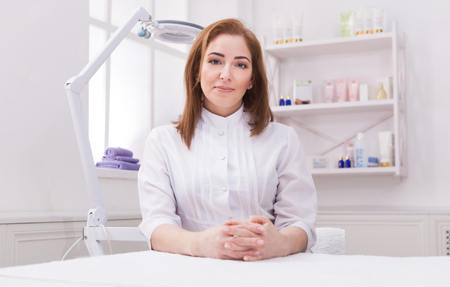 Woman beautician doctor at work in spa center. Portrait of a young female professional cosmetologist. Healthcare occupation, medical career