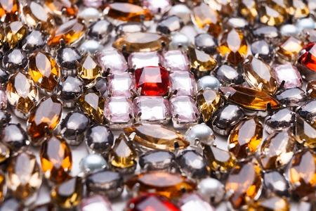 diamond stones: Colorful gemstones variety, precious stones background. Assortment of bright mounted gemstones, jewelry production concept