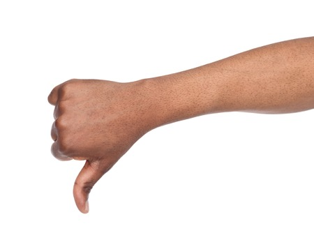 Thumb down sign isolated on white background. Black male hand showing disapproval gesture, dislike, disagree concept