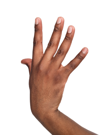 Black male hand isolated on white background. African american man showing back of his palm Stock Photo