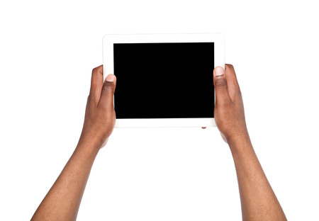 hands free device: Black man holding digital tablet isolated. African american man with gadget with blank screen, copy space for advertisement