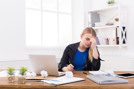 Tired pregnant businesswoman at office copy space. Expectant business lady feeling sick at work, gestosis concept