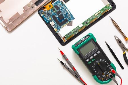 Electronics repair flat lay background. Dissasembled tablet top view, copy space. Stock Photo - 81783194