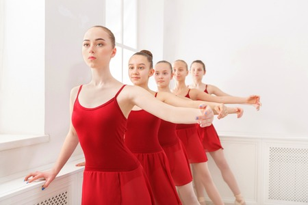 a rehearsal: Young ballerinas practicing ballet in classical dance school