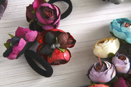 scrunchie: Variety of hair rubbers decorated with flowers. Beautiful handmade scrunchies assortment, female decoration, beauty concept