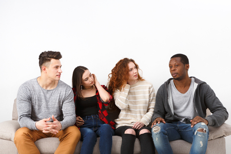 african student: Happy young multiethnic students, friends in casual talking, leisure and party time Stock Photo