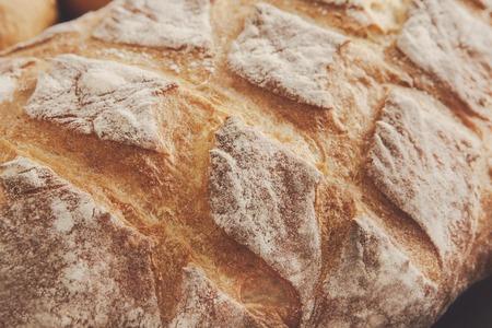 checker: Bread texture crust closeup background, fresh checkered loaf