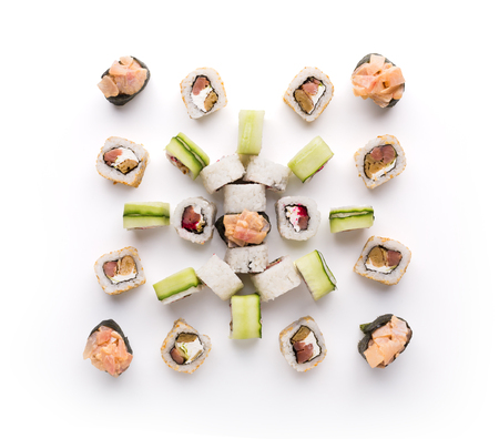 Sushi assortment isolated on white background. Big set of seafood rolls covered with cucumber and spicy gunkans. Japanese food delivery