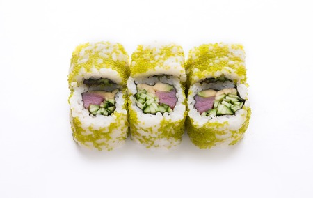 Healthy japanese restaurant food delivery. Set of tuna and vegetables rolls in green caviar, isolated at white, closeup. Stock Photo